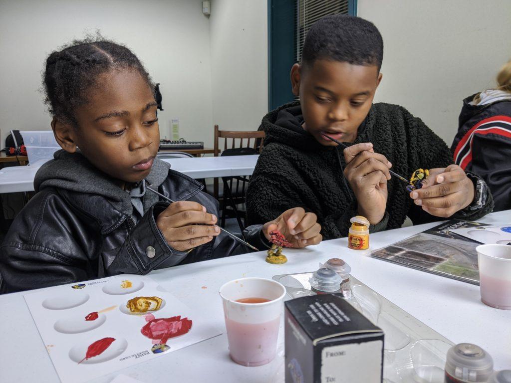 Kids Painting RPG Miniatures