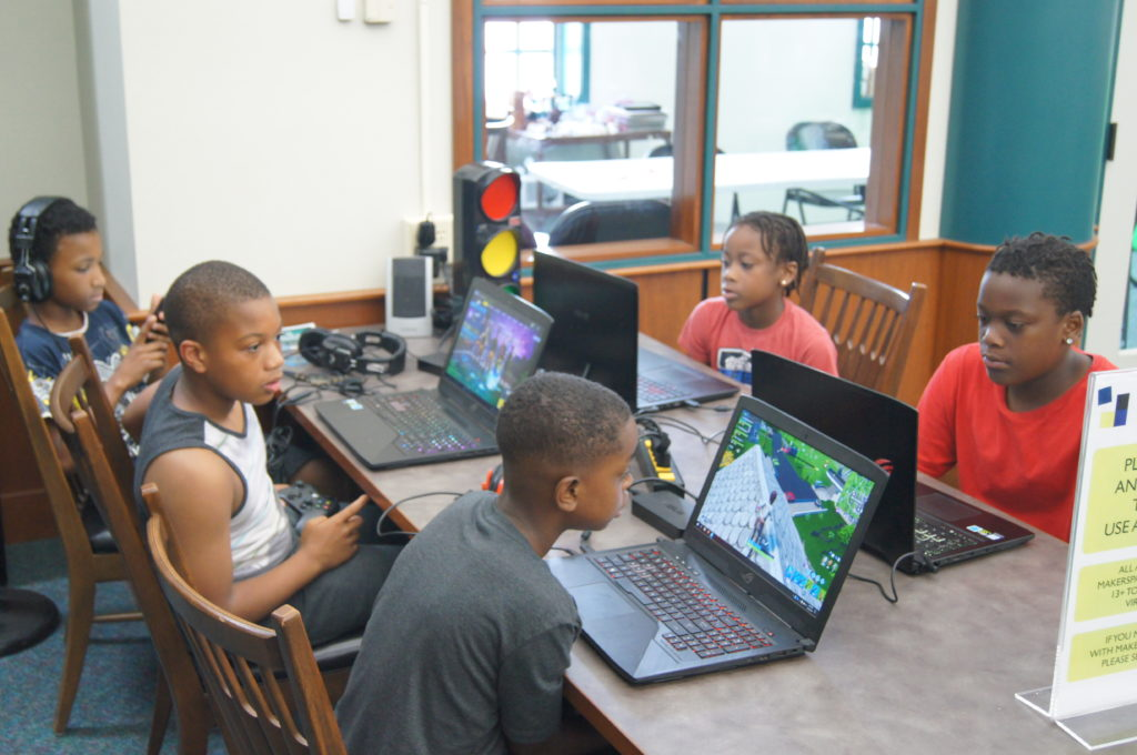 Photo of Kids Playing video games