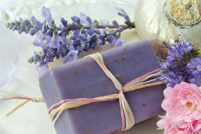 Photo of a bar of purple soap with lavender flowers
