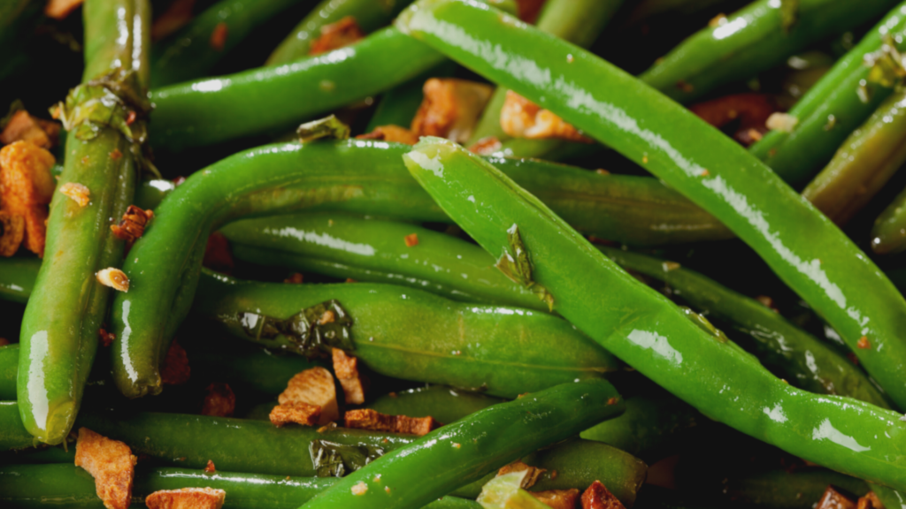 close up of green beans and bacon